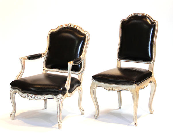 A set of four Louis XV style painted and parcel gilt chairs