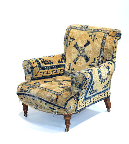 A Victorian walnut armchair, now upholstered in a Peking carpet