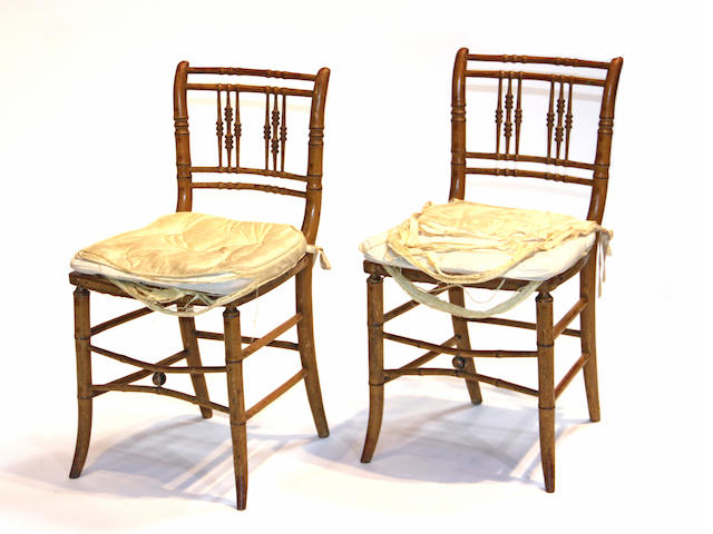 A pair of Regency painted side chairs