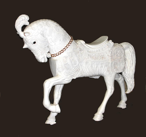 After Marcus Illions<BR />A carved wood and painted carousel horse
