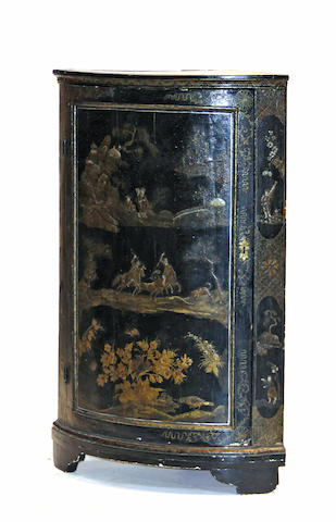 A Continental parcel gilt and japanned corner cabinet fourth quarter 18th century