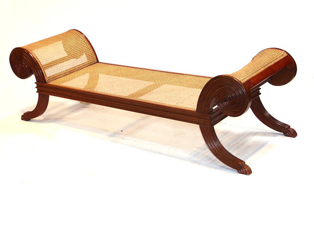 A Neoclassical style mahogany caned bench