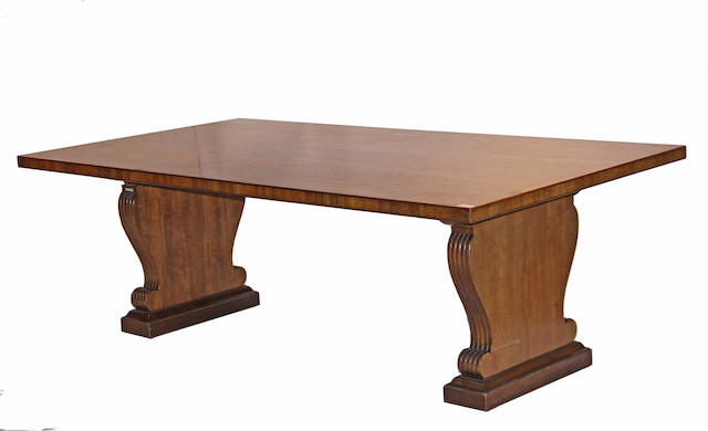 A Neoclassical style Indian laurel wood dining table
