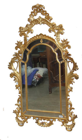 A Louis XV style giltwood mirror, early 20th century