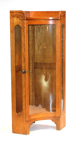 An American oak concave corner vitrine cabinet late 19th century