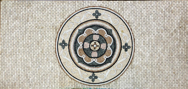 A contemporary tumbled marble mosaic panel