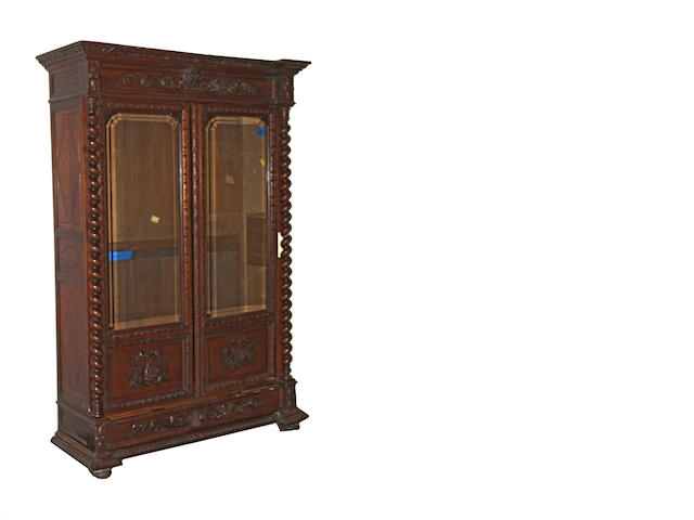 A Renaissance Revival oak bookcase cabinet fourth quarter 19th century
