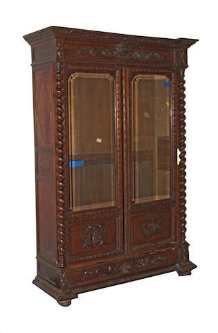 A Renaissance Revival oak bookcase cabinet fourth quarter 19th century