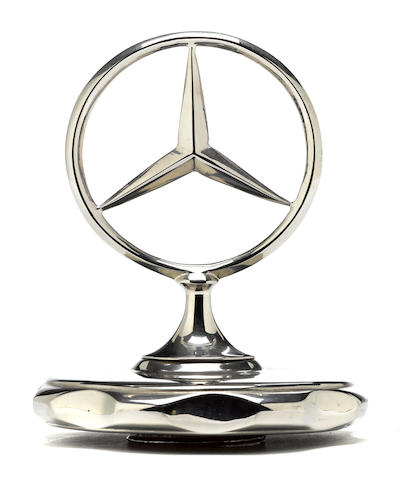 A Mercedes-Benz three pointed star radiator cap,