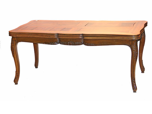 A Louis XV style walnut draw leaf table 19th century