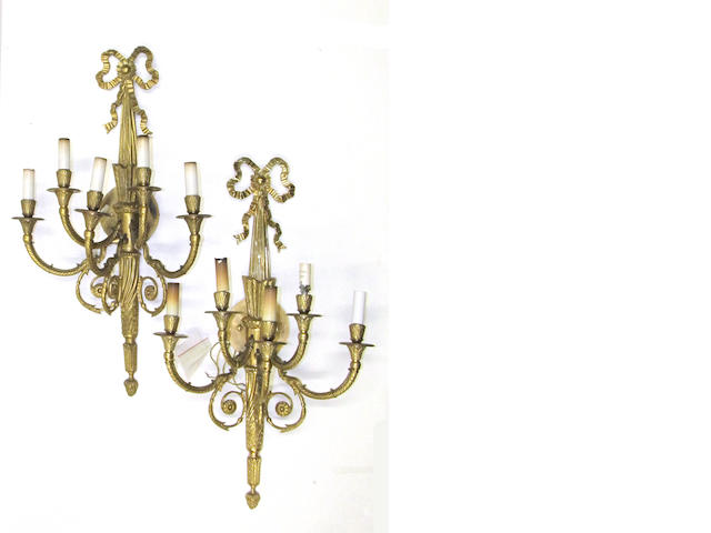 A pair of Louis XVI style gilt bronze five light bras de lumière  Laspec Lighting, Los Angeles<BR />late 20th/early 21st century