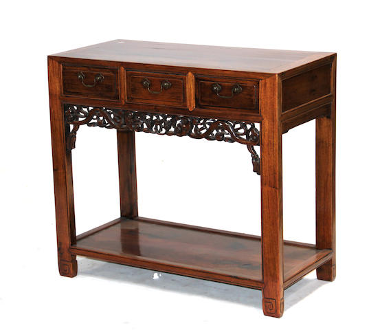 A Chinese three-drawer hardwood side table with lower shelf Late Qing/Republic period