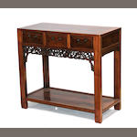 A Chinese three-drawer hardwood side table with lower shelf