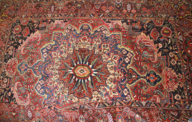 A Bakhtiari carpet size approximately 12ft. 10in. x 15ft. 9in.