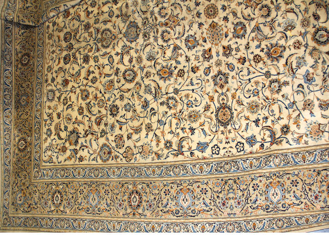 A Kashan carpet size approximately 12ft. 10in. x 18ft. 10in.