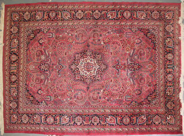 A Meshed carpet size approximately 8ft. 8in. x 12ft. 1in.