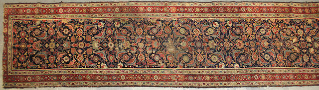 A Northwest Persian runner size approxmately 3ft. 2in. x 14ft.