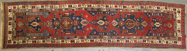 A Serab runner size approximately 3ft. 4in. x 12ft. 4in.