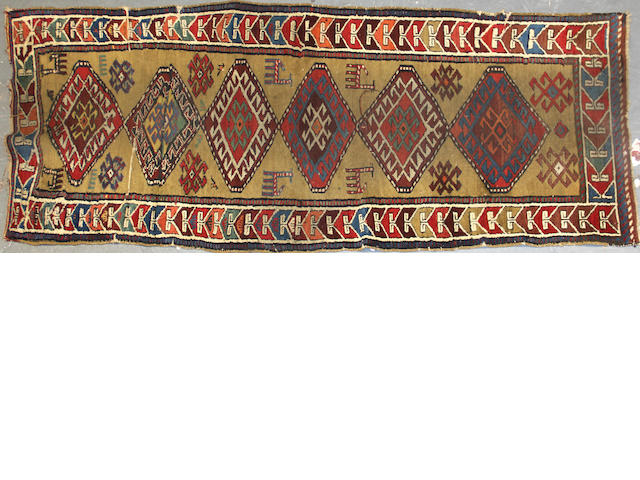 A Kurdish runner size approximately 3ft. 2in. x 8ft.