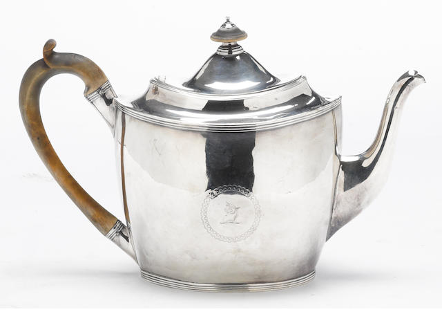 A George III silver teapot with wooden fittings Peter, Ann & William Bateman, London, 1803 <BR />With crest
