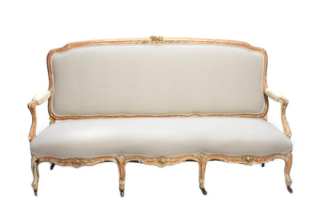 A Louis XV style giltwood settee