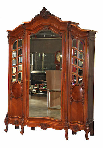 A Louis XVI style walnut and glazed door armoire and bed late 19th century