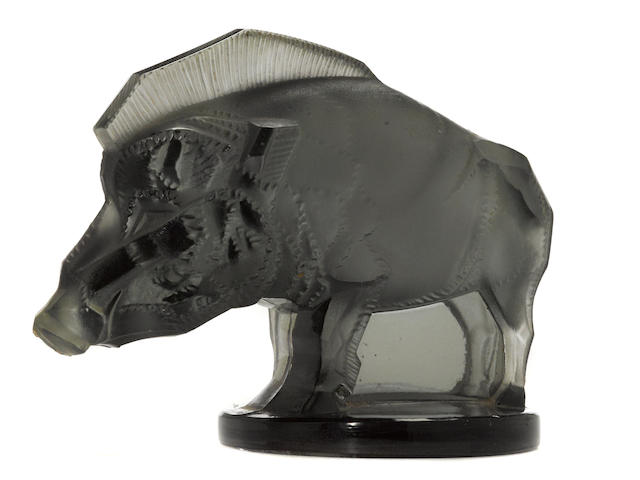 A 'Sanglier' mascot in dark 'fumee' glass, by René Lalique, French, 1929,