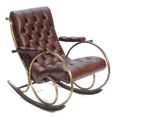 A French brass and steel rocking chair