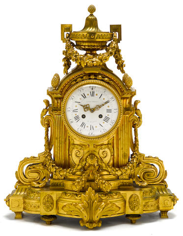 A Louis XVI style gilt bronze matel clock<BR />late 19th century