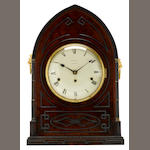 A George IV Gothic style mahogany and partial ebonized quarter chiming mantel clock<BR />Farmer, London<BR />first quarter 19th century