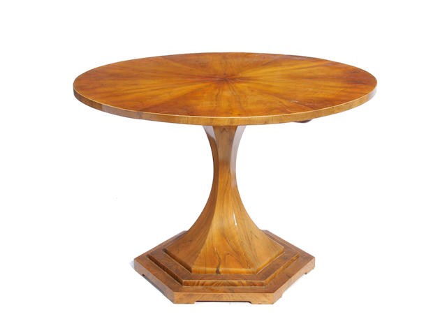 A Biedermeier walnut tilt top center table