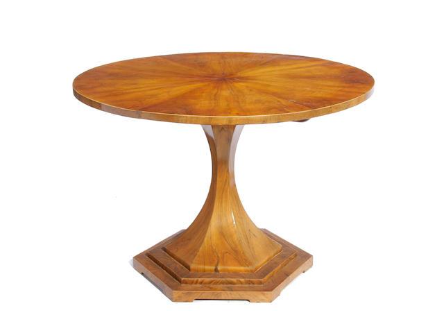 A Biedermeier walnut tilt top center table