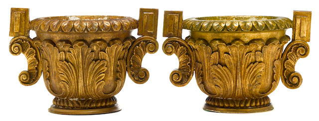 A Michael Taylor pair of Baroque style two handled giltwood urns  third quarter 20th century