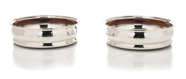 a pair of English silver bottle coasters; diameter 5 1/4in