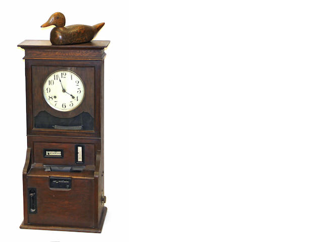 An American oak time clock late 19th century
