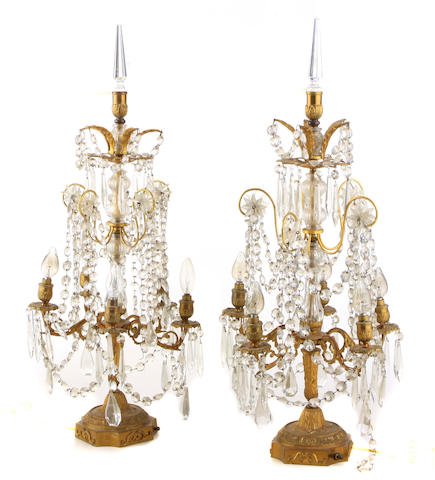 A pair of Louis XVI style gilt metal and cut glass girandoles