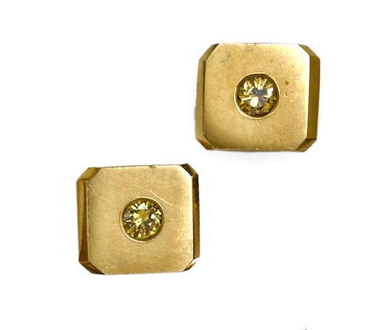 A pair of yellow diamond cufflinks