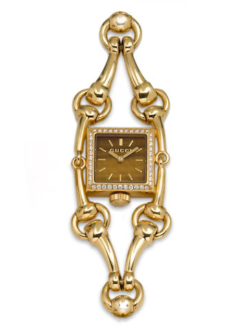 A diamond and 18k gold bracelet wristwatch, Gucci