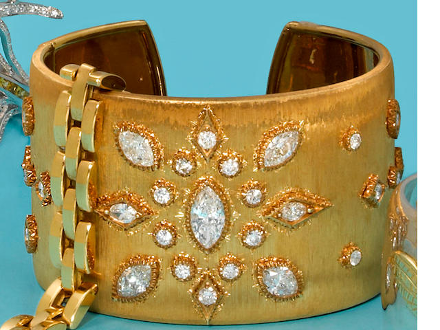 A diamond cuff bangle bracelet