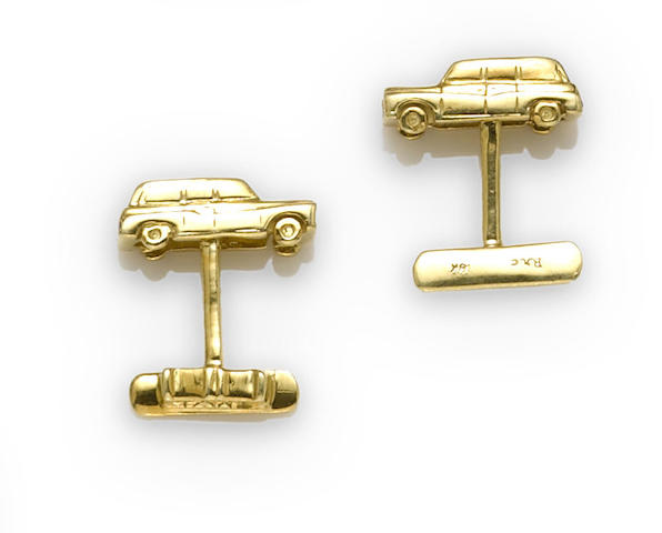 A pair of diamond, ruby, and eighteen karat gold British taxicab cufflinks
