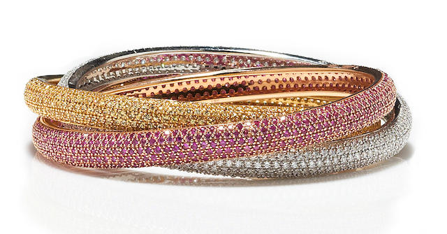A diamond and pink and yellow sapphire rolling bangle bracelet