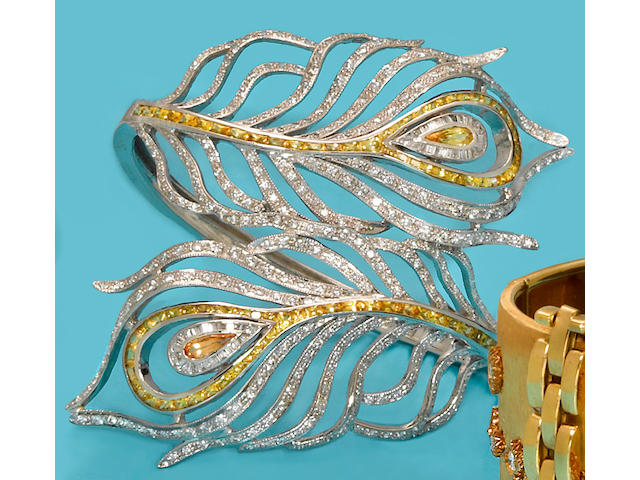 A yellow sapphire and diamond peacock feather cuff bracelet