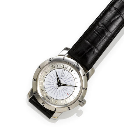 Tissot. A stainless steel automatic world time wristwatch with box