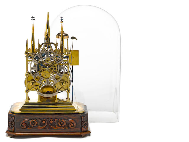 An English Gothic revival 'Litchfield Cathedral' skeleton clock<BR />Bennett, 65 Cheapside, London<BR />second half 19th century