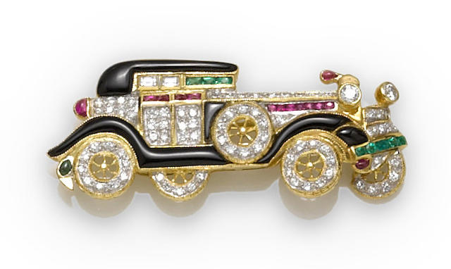 A diamond, ruby, emerald and black onyx classic car brooch