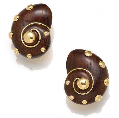 A pair of carved wood and eighteen karat gold spiral shell motif earclips, Verdura