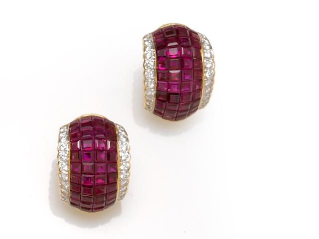 A pair of ruby and diamond half-hoop earclips