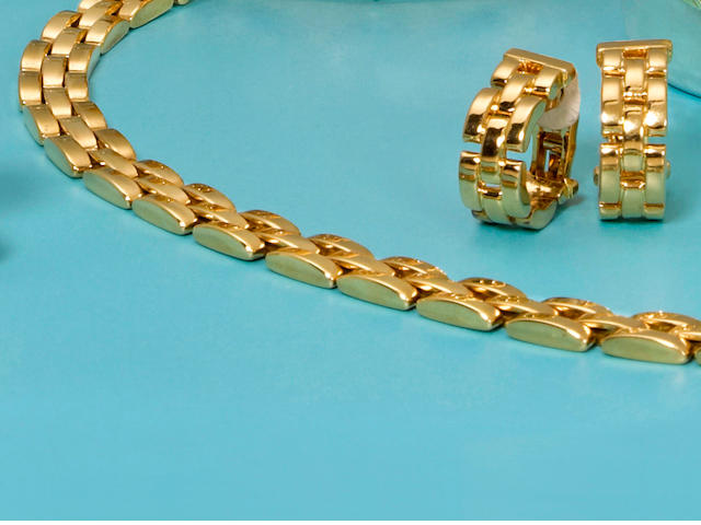 "An eighteen karat gold ""Maillon Panthère"" necklace together with a pair of earclips, Cartier"