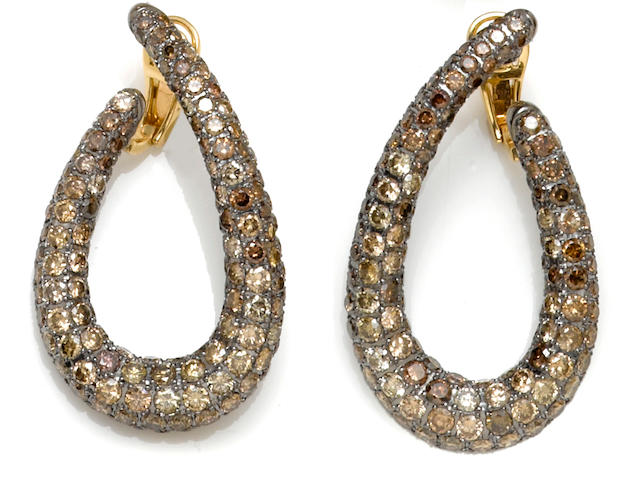 A pair of colored diamond hoop earrings