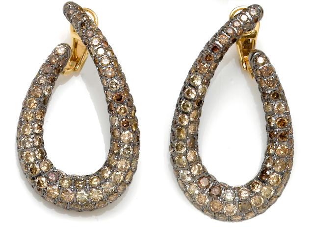A pair of colored diamond hoop earrings